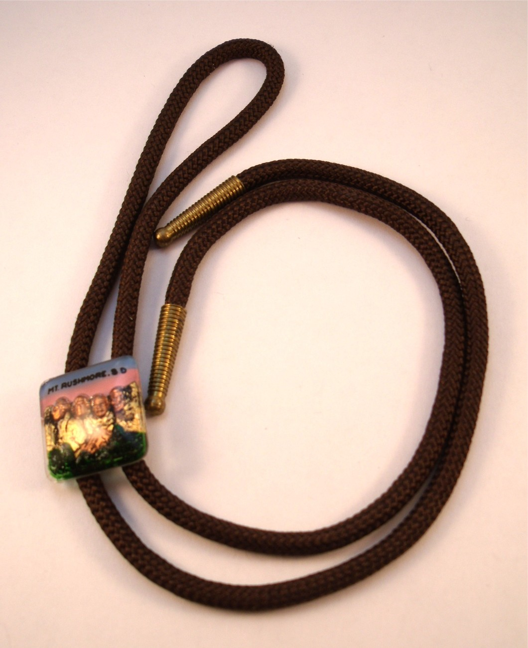Reverse carved painted Mount Rushmore Bolo tie