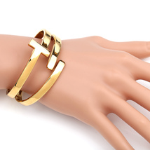 UE- Designer Gold Tone Contemporary T-Bar Hinged Cuff Bangle Bracelet - $19.99
