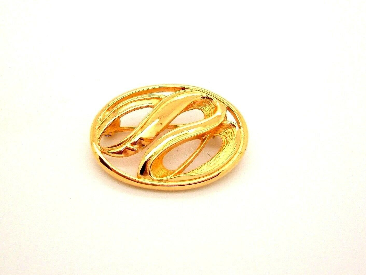 Primary image for Trifari Gold Tone Oval Small Swirl Brooch Pin Abstract Modern vtg