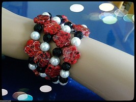 Coil cuff bracelet w dark red splatter flowers white glass pearls black ... - $13.95
