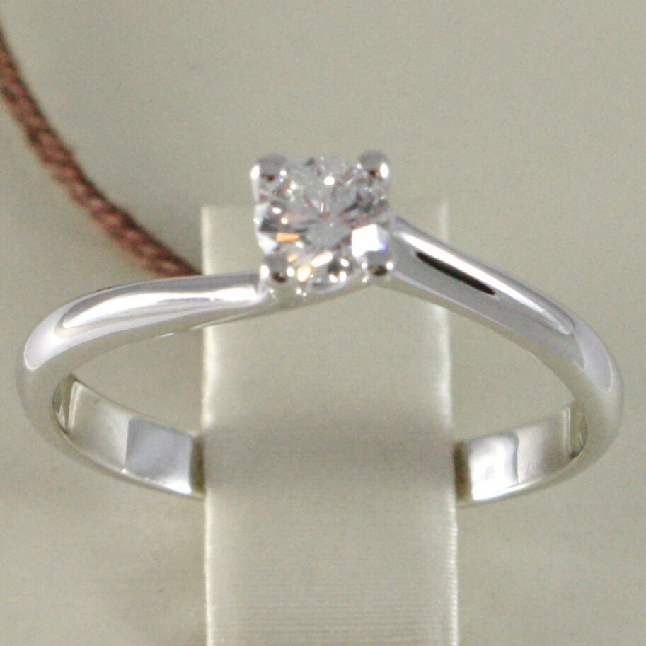 WHITE GOLD RING 750 18K, SOLITAIRE, STEM CRISS CROSSED, DIAMOND CARAT 0.26