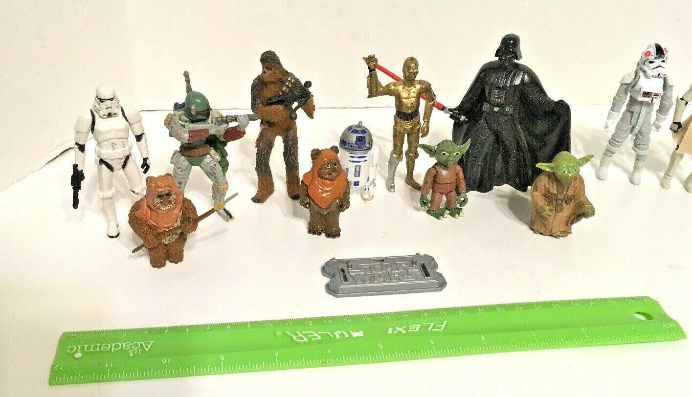 Star Wars Figurines 26 Piece Lot Includes Unknown Figurines Weapons Vehicles