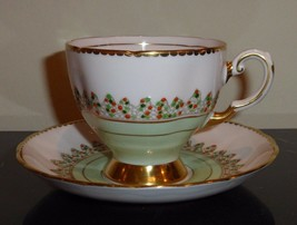 Vintage TUSCAN FINE BONE CHINA Pale Pink and Pale Turquoise Cup and Saucer - $75.00