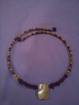 CHOKER - this a choker brown wood beads with a white sculpted bead in ce... - $8.00
