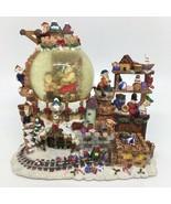 Grandeur Noel 2000 Santas Workshop Snow Globe Christmas plays Jingle Bel... - $56.09