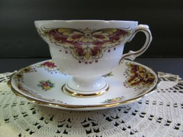 Rosina Maroon Motif Surrounding Pink Flower footed Tea Cup and Saucer - $23.76