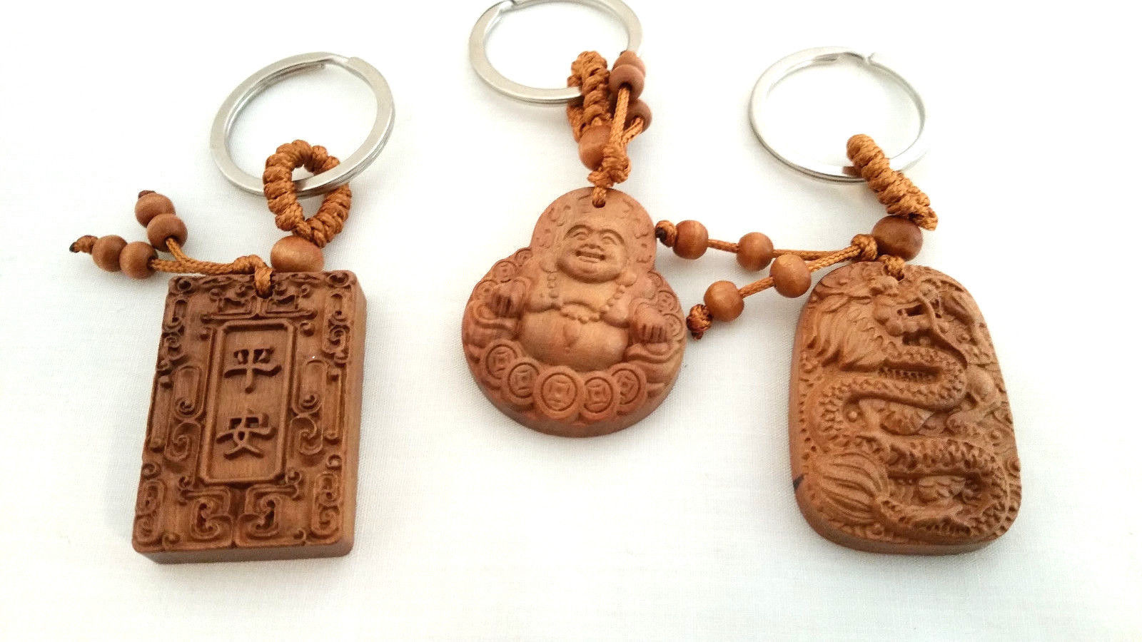Set of 3 NEW  Bamboo Good Luck Key chains Buddha, Dragon, and Holy Book