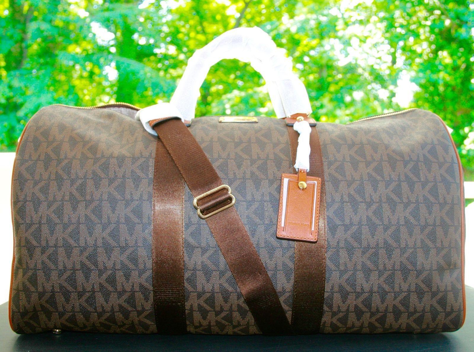 2504a634131f S l1600. S l1600. Previous. New MICHAEL KORS Signature XL Travel Duffle Bag  weekender $458. New MICHAEL ...