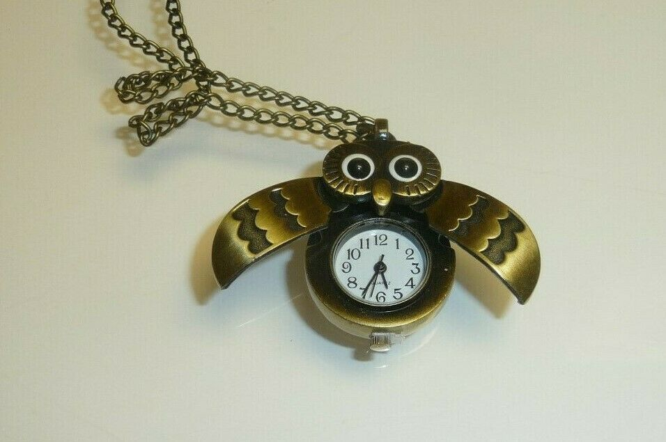 Unused,Working Owl Watch,Wings open to expose time piece,Tag attached