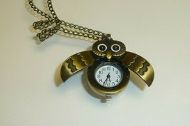 Unused,Working Owl Watch,Wings open to expose time piece,Tag attached - $19.79