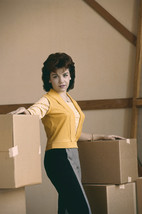 Annette Funicello 1960's posing in warehouse with boxes 18x24 Poster - $23.99