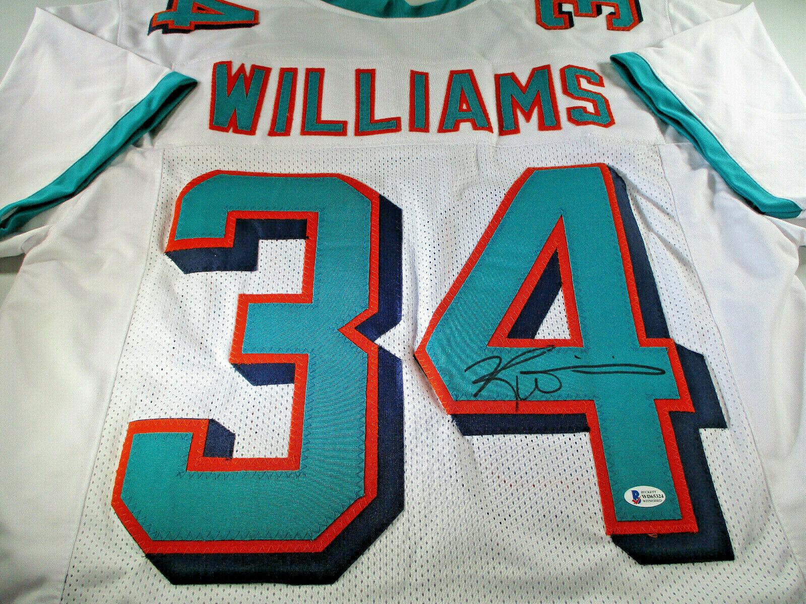 RICKY WILLIAMS / NCAA H.O.F / AUTOGRAPHED MIAMI DOLPHINS CUSTOM JERSEY / BECKETT