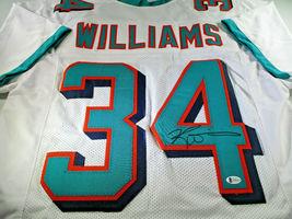 RICKY WILLIAMS / NCAA H.O.F / AUTOGRAPHED MIAMI DOLPHINS CUSTOM JERSEY / BECKETT image 1