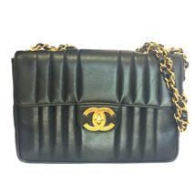 Vintage CHANEL black 2.55 jumbo caviar leather large shoulder bag with golden CC - $3,332.00