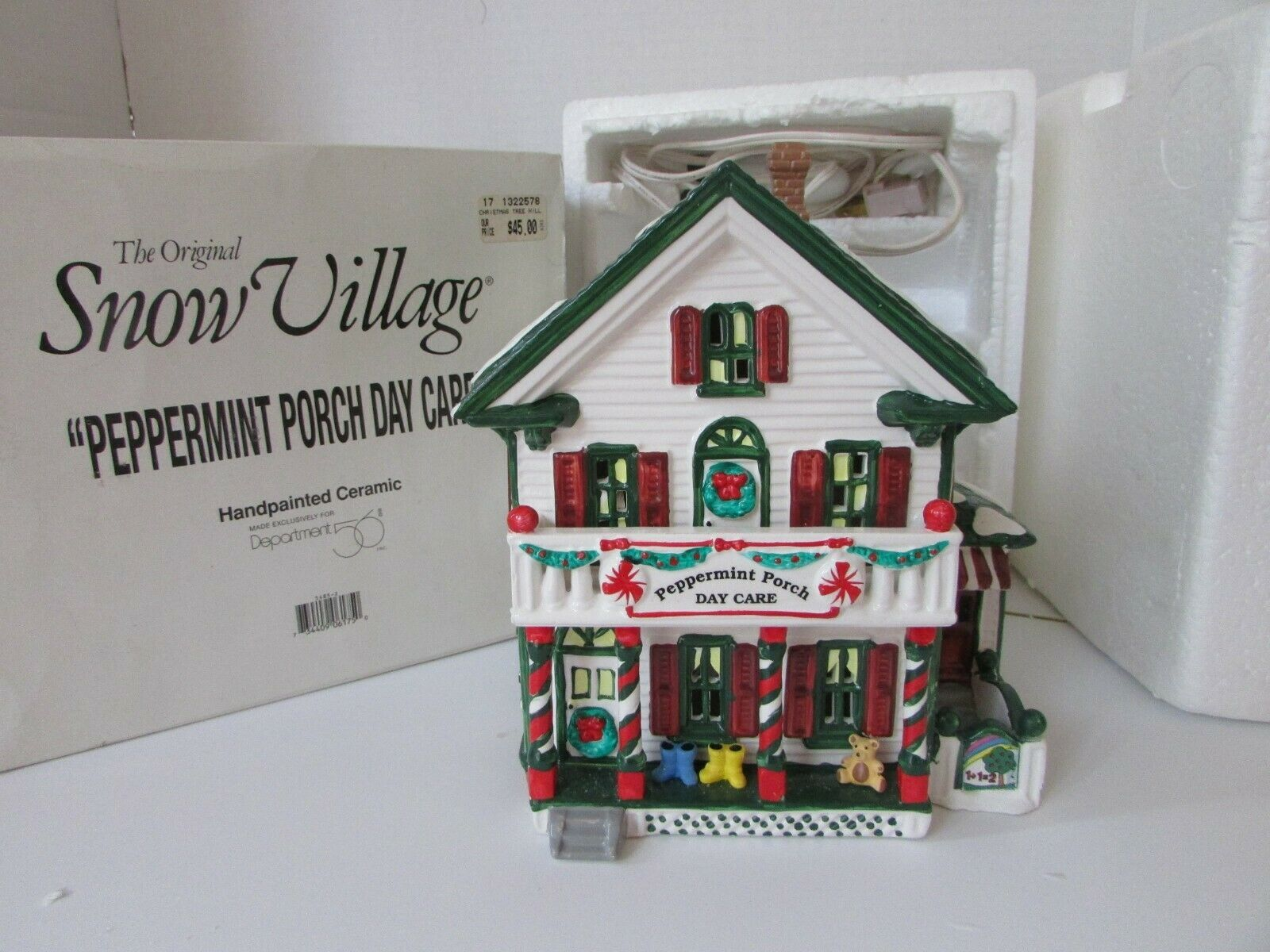 Primary image for DEPT 56 54852 SNOW VILLAGE PEPPERMINT PORCH DAY CARE LIGHTED BLDG  D10