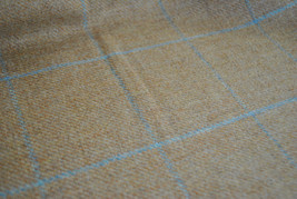 Tweed material by the metre in light brown/beige with windowpane in blue fabric