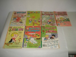 Lot of Seven (7) Richie Rich Comic Books Paperbacks Casper Success Jacki... - $26.14