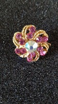 Brooch with ab crystal eye and pink crystals surrounding centre stone in gold cm