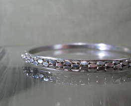 Sparkling Silver Bangle Bracelet, Sun Catching Polished Diamond Shapes ... - $12.75