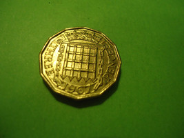 1967 UNCIRCULATED ENGLISH BRASS THREE PENCE COIN             COMBINED SH... - $3.71