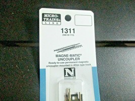Micro-Trains Stock # 98800173 (1311) Magne-Matic Uncoupler mounted in Track image 2