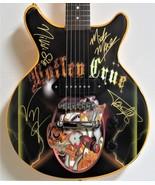 Motley Crue Autographed Generation Swine Guitar - $1,800.00