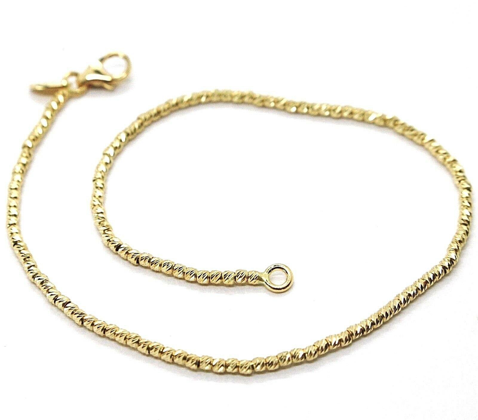 18K YELLOW GOLD BRACELET WITH FINELY WORKED SPHERES, 1.5 MM DIAMOND CUT BALLS