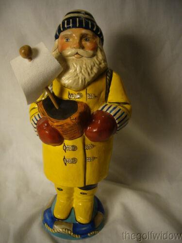 Vaillancourt Folk Art Sea Coast Santa in Yellow Slicker Holding Boat Signed