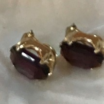 Vintage Goldtone Prongset Oval Faceted Dark Purple Rhinestone Clip Earri... - $10.39