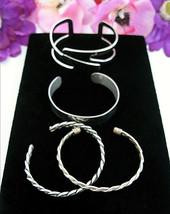 Lot Of 4 Cuff Bracelets Vintage Silvertone 2 Braided Twist 1 Open Work 1 Plain - $14.99