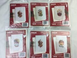Six Janlynn Christmas cross stitch card kits angel bear and Christmas tr... - $23.36