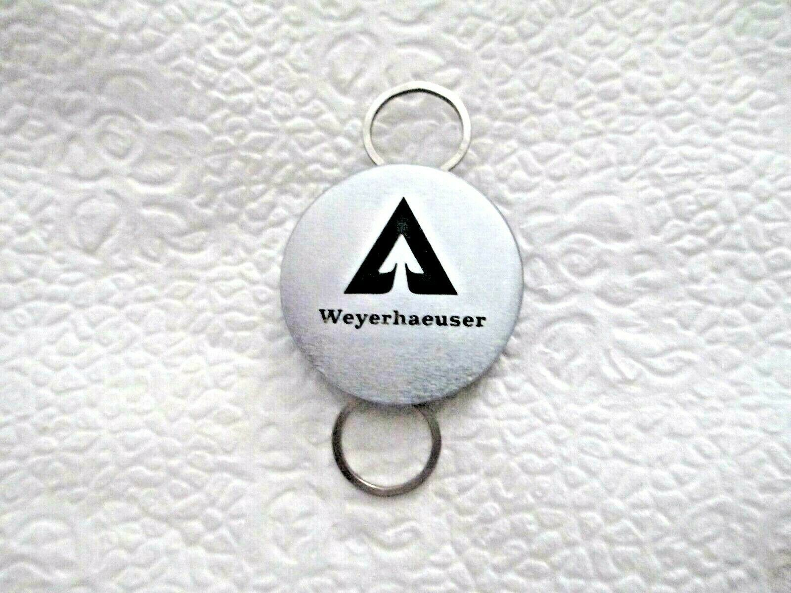 "Primary image for Weyerhaeuser Logo 1.25"" Round Silver Tone Key Chain Double Ring - Rings Move"