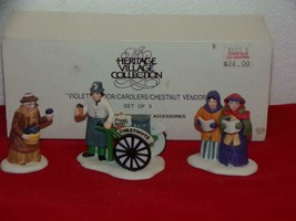 DEPT 56 - CHRISTMAS IN THE CITY-VIOLET VENDOR/ CAROLERS/CHESTNUT VENDOR-MIB - $12.73