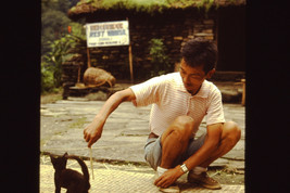 35mm Slide Annapurna Sanctuary Nepal Local Man Playing with a Cat (#24) - $4.75