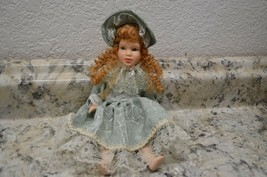 """Vintage 9""""  PORCELAIN DOLL JOINTED  in a dress and bonnet - $14.98"""