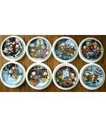 Garfield's 8 plate Christmas collection by the Danbury Mint . - $300.00