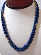 NAVY BLUE AND GOLD TONE ACCENT SPRING COIL ROUND BEADS LONG PLASTIC NECK... - $24.00