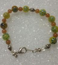 Multi color Multi shape Universal bracelet 8 1/2  inch Glass Bracelet - $4.90