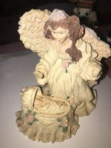 Angel Figurine With Baby Chipped Wing  - $6.79