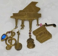 Vintage Piano Brooch Lapel Pin Dangling Charms Music Note Treble Clef Banjo - $12.86
