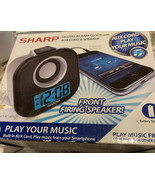 Sharp digital alarm clock with auxiliary cord and speaker - $19.39