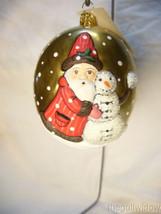 Vaillancourt Folk Art Santa on Gold Jingle Ball with Snowman image 1