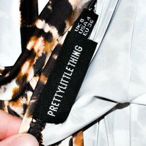 Pretty Little Thing Women's Leopard Animal Print Open Neck Wrap Crop Top Size 4 image 3
