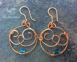 Handmade copper earrings: circular swirling design with aqua bicone crystal - $30.00