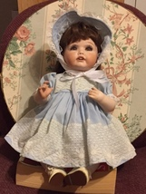 Beautiful Porcelain doll with clothing - $10.00