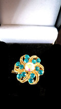 Brooch with ab crystal eye and blue crystals surrounding centr