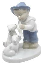 """VINTAGE Porcelain Boy w/ 2 Dogs Figurine BLUE CROWN STAMP 4.25""""H - $35.99"""