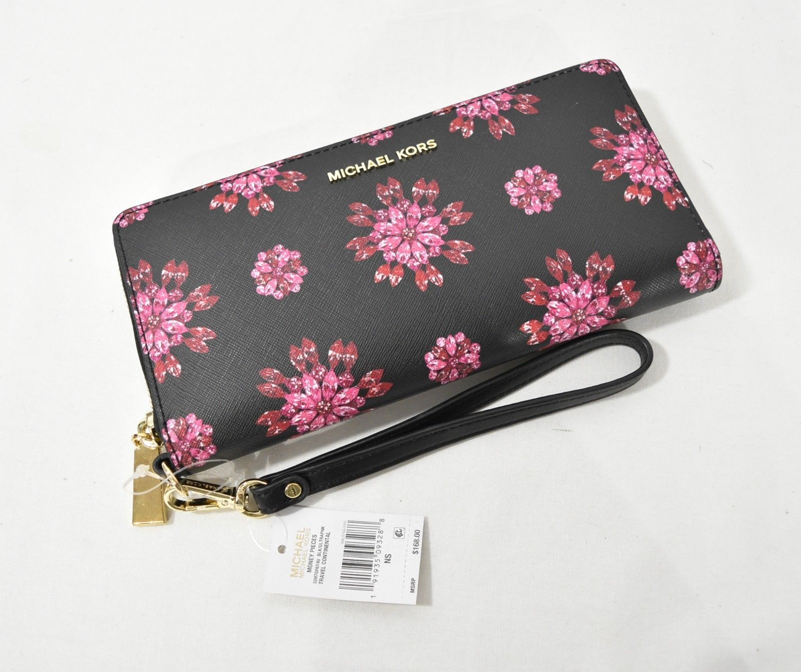 c9d0344559eb S l1600. S l1600. Michael Kors Money Pieces Travel Continental Wallet in  Black Ultra Pink Flowers