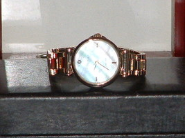 Pre-Owned Women's Anne Klein Mother of Pearl Diamond AK/1918 Quartz Watch - $21.78