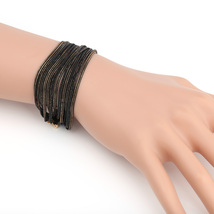 UE- Exquisite Gold Tone With Black Overlay Multi Strand Designer Bracelet  - $14.99